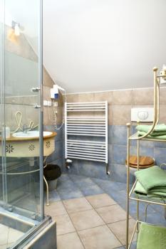 Pokojová koupelna v hotelu Via Ironia 2